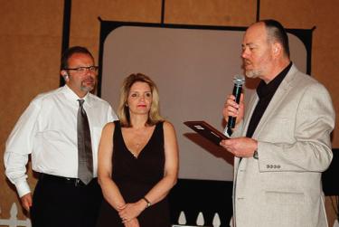 "Dax & Lauri receiving 1"" capsule award for Sqwishland"