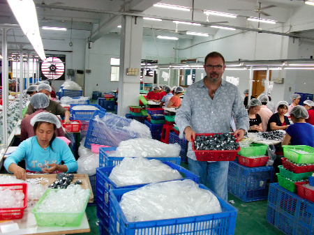 Dax Logue at the Sqwishland factory in China